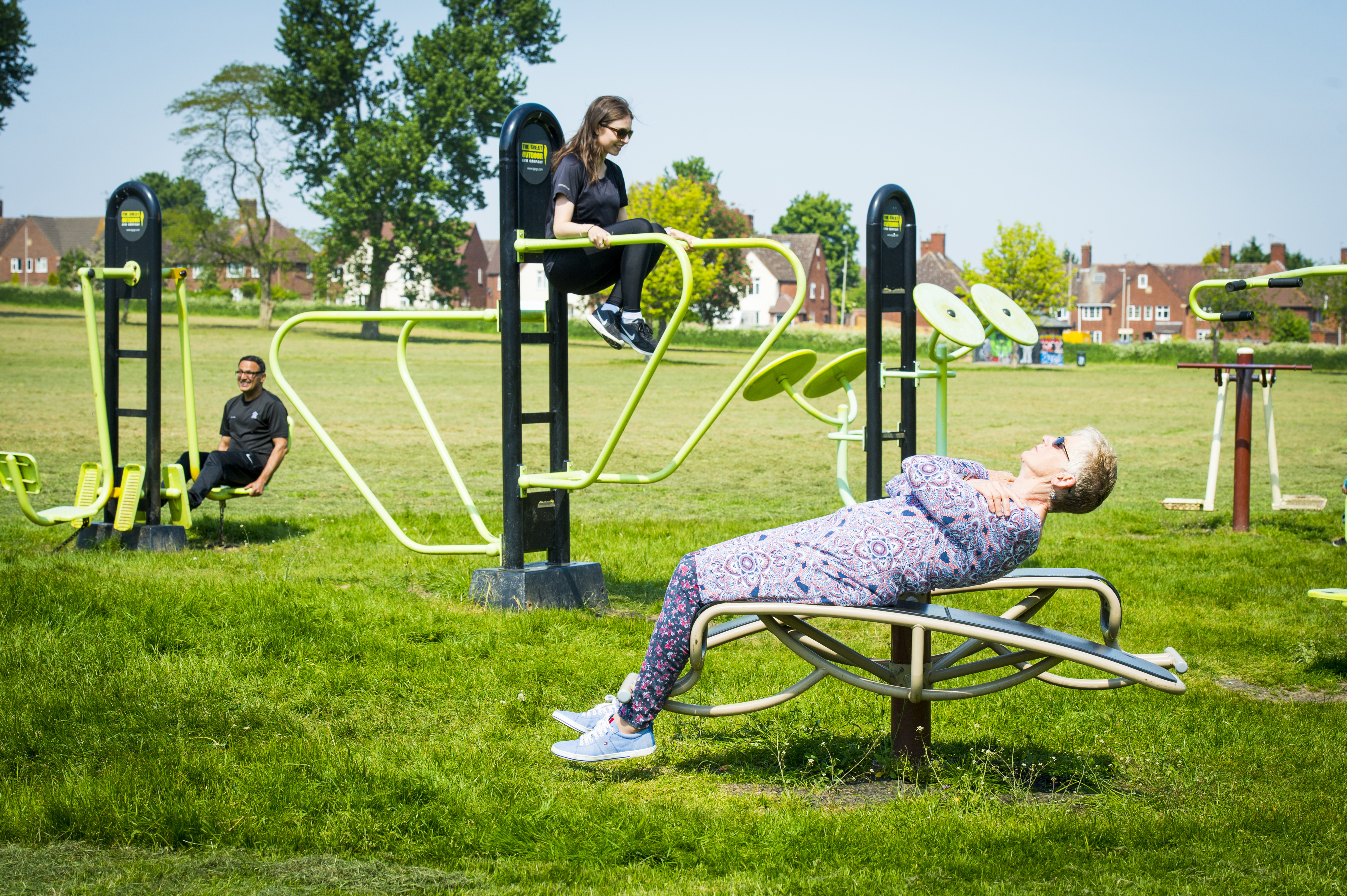 Lady using outdoor gym